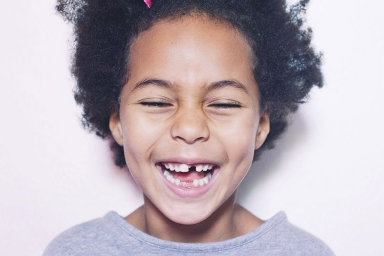 smiling child with gap teeth